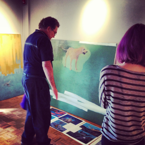 Student Nicki Ralar assists gallery director, David Behlke arranging art at Koa Gallery. Photo Koa Gallery Blogspot